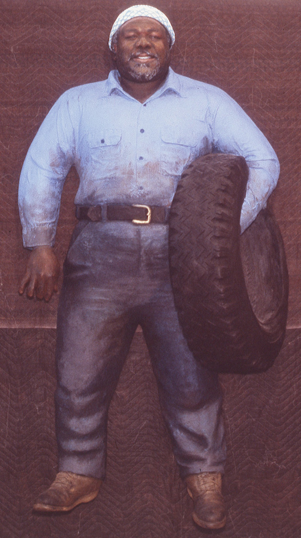 John Ahearn - Pedro with Tire, 1984, painted cast plaster
