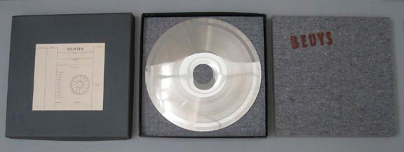 Joseph Beuys - Sonnenscheibe, 1973, record matric (nickel-plated copper) with die-cut hole; two felt pads stamped with brown paint (Browncross); in box