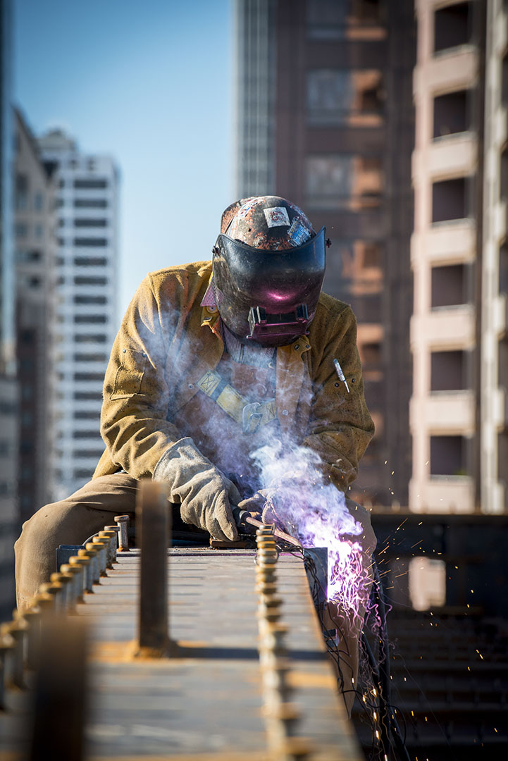 Construction worker welding steel beams on The Broad structure; photo by Nathaniel Riley