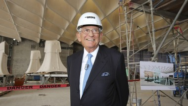 Eli Broad wearing a hard hat standing at the construction site of The Broad museum