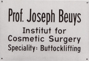 Joseph Beuys - Buttocklifting, 1974, sign, baked enamel on convex metal sheet