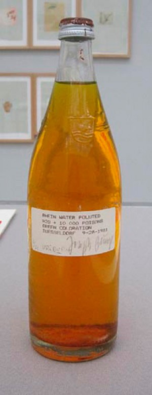 Joseph Beuys - Rhine Water Polluted, 1981, bottle containing green-dyed Rhine water, label, screw-cap with oil paint (Browncross)