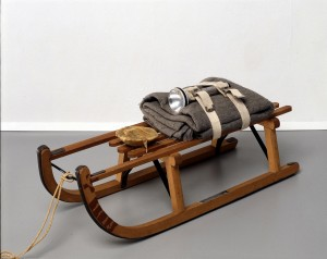 Joseph Beuys - Schlitten, 1969, wooden sled, felt, belts, flashlight, fat and rope; sled stamped with oil paint (Browncross)