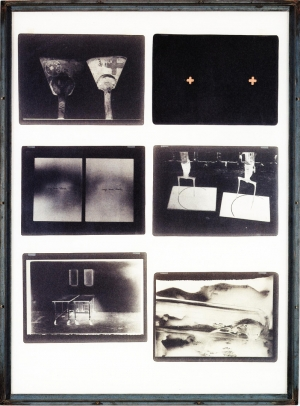 Joseph Beuys - zeige deine Wunde, 1977, photographic negatives, brown paint, glass, white glass and iron frame
