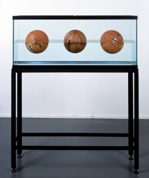 Jeff Koons - Three Ball 50/50 Tank (Two Spalding Dr. J Silver Series, Wilson Supershot), 1985, glass, steel, distilled water and three basketballs