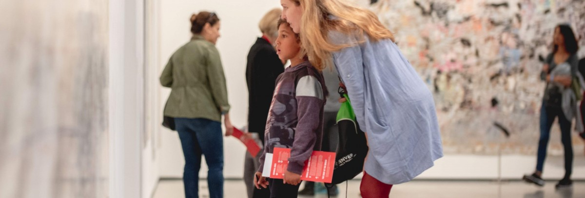 Photo of a woman and a boy looking at a painting at The Broad together
