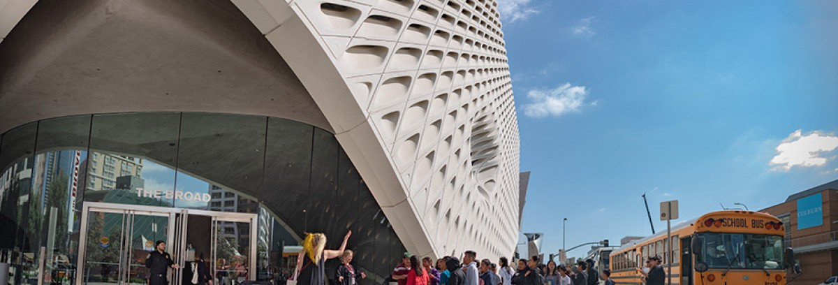 Photo of a school group disembarking a bus in front of The Broad museum
