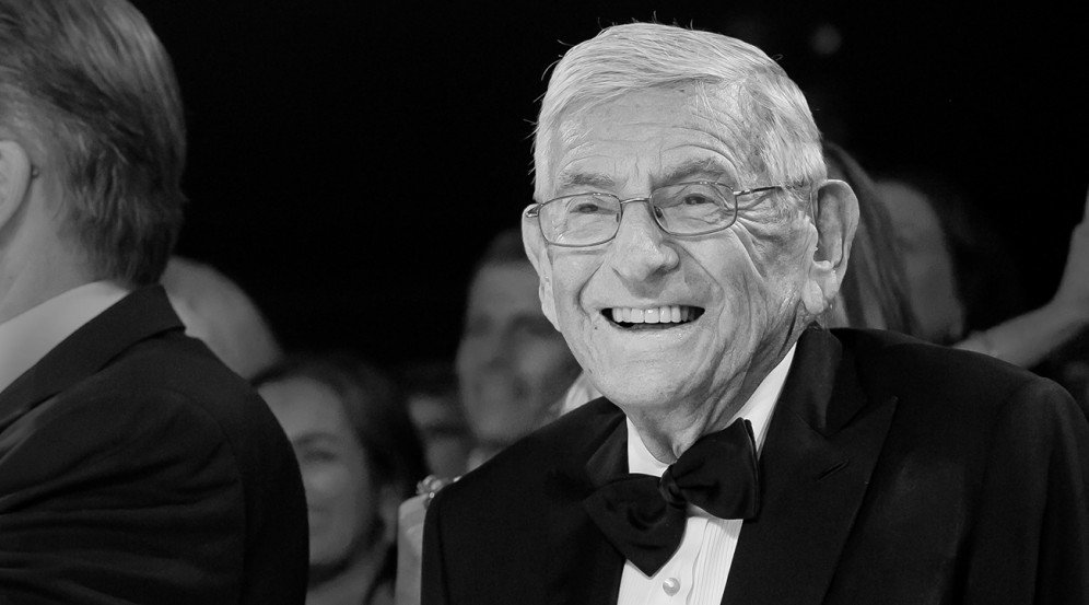 Black and White photo Eli Broad smiling wearing a black tuxedo with bow tie