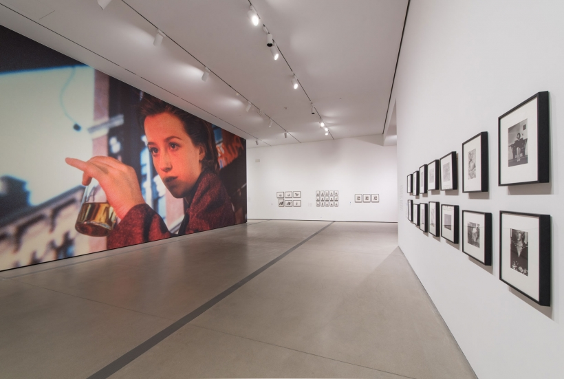 Cindy Sherman: Imitation of Life Installation Photo with Mural and Bus Riders